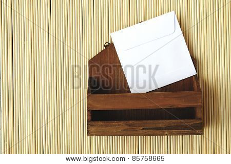 Small Letter Box And White Envelope