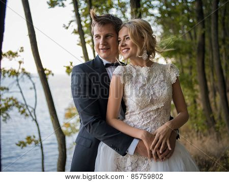 Beautiful, young wedding couple on the background of beautiful n