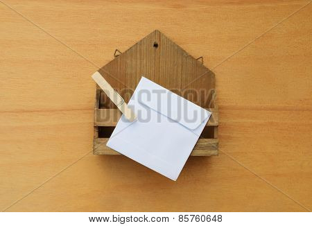 Small Wooden Letter Box With White Envelope