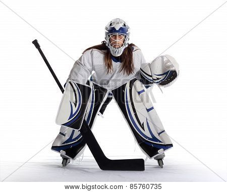 Young ball hockey goalie in white jersey.