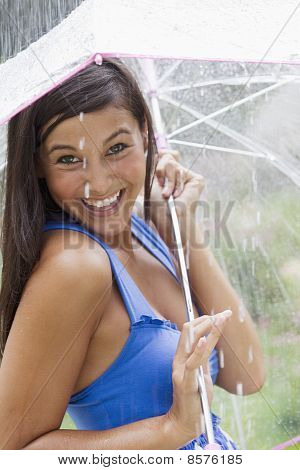Young Woman Using an Umbrella in Rain