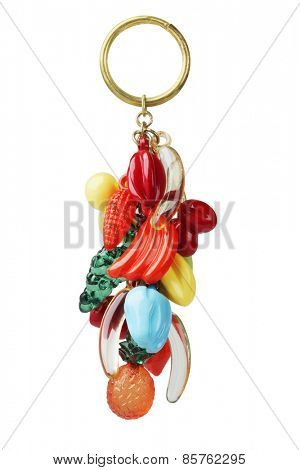 Key Chain With Plastic Fruits Trinket On White Background