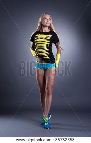 Charming long-haired blond woman in sportswear