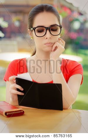 Sad Woman Checking Restaurant Bill