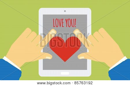 device with heart on the screen holding in hands