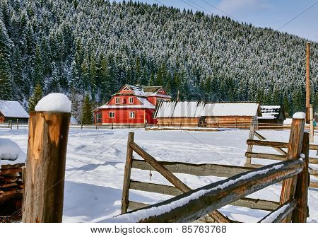 Mountain chalet in the snow landscape