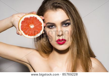 Pretty Glamour Girl Holding Grapefruit