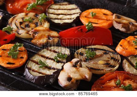 Vegetables Cooked In A Black Skillet Grill Macro. Horizontal