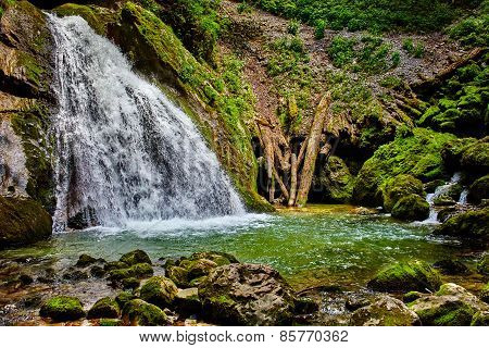 Waterfall And River In Canyon