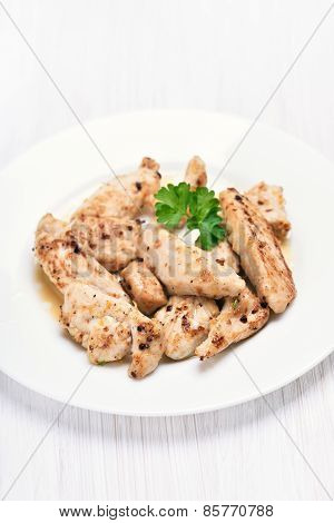 Grilled Chicken Meat Sliced On White Plate