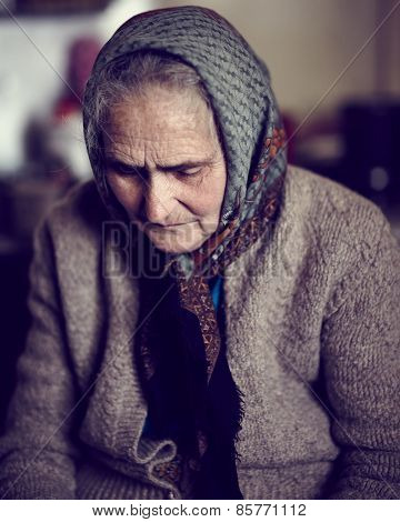 Closeup Of An Old Sad Woman Indoor