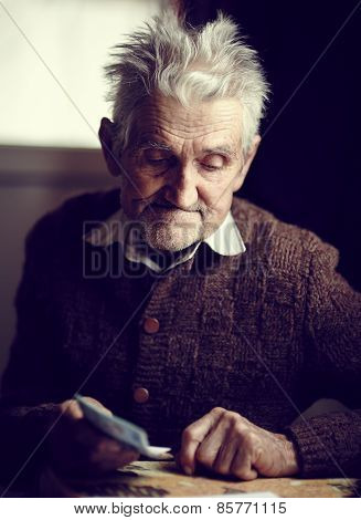 Senior Farmer Holding Money