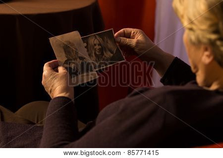 Grandma Looking At Grandchild's Photos