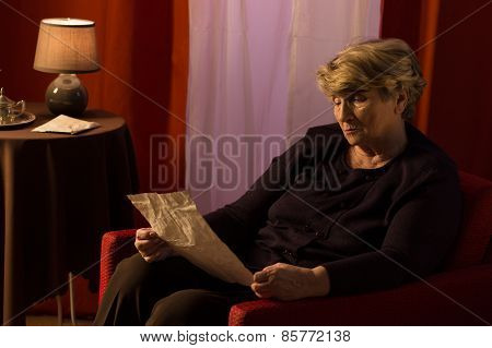 Melancholic Retiree Reading Old Letter