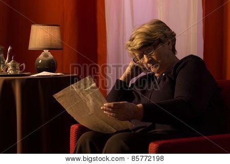 Senior Woman Reading Old Letter