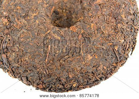 Half of chinese puer tea disc on white background