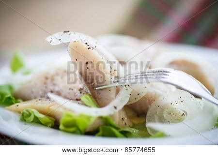 Pieces Of Salted Herring With Onions