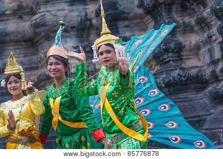 SIEM REAP,CAMBODIA-Feb 24, 2015:An unidentified cambodians in national dress poses for tourists in Angkor Wat,on Feb 24, 2015,Siem Reap,Cambodia.Angkor is the country's prime attraction for visitors.