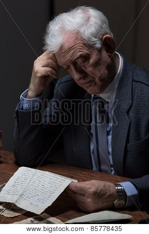 Lonely Man Reading Old Letter