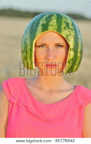 young woman model with water-melon on head
