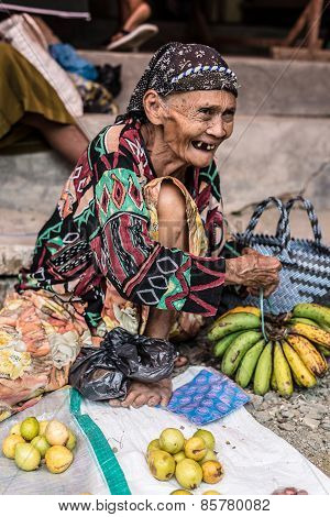 Indonesia: Portrait Of Senior Market Vendor