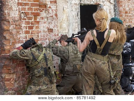 Attractive Womens In Military Uniform, Holding Gun And Aim To Shoot