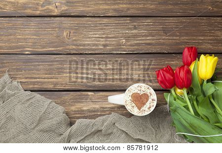 Cappuccino With Heart Shape And Bouquet Of Tulips