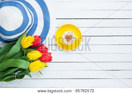 Cup Of Cappuccino With Heart Shape And Bouquet Of Tulips