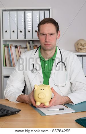 Young Family Doctor With Piggy Bank Is Angry