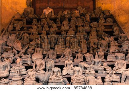 Headless Buddha statues at Wat Si Saket.