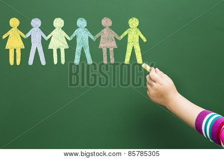 Child drawing united people on blackboard