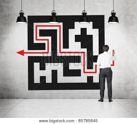 Businessman Drawing Maze