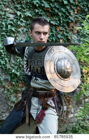 ZAGREB, CROATIA - OCTOBER 07, 2012: Man dressed in medieval clothes with sword, posing after the