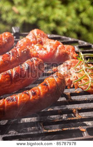 Grilling Sausages.