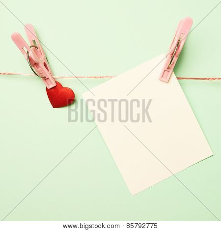 Heart and greeting card attached with a clothespin