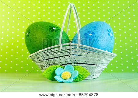 Green And Blue Easter Eggs In A Basket With Blue Flower