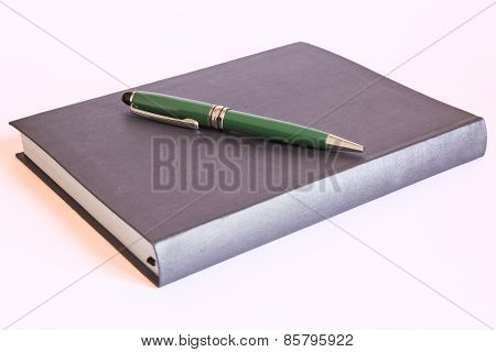 pen on book