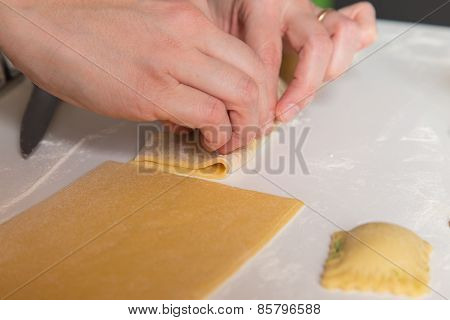 Ravioli stuffed with cheese and spinach