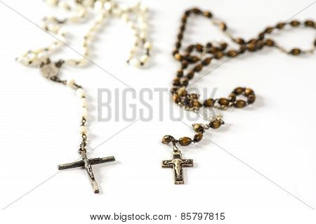 Two rosary on white