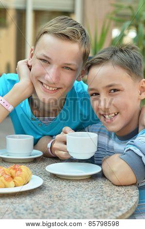 Happy boys at breakfast