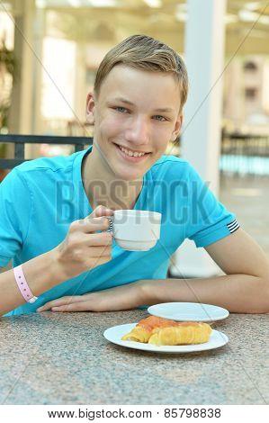 Happy boy at breakfast