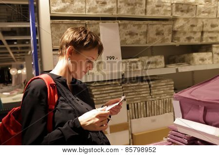 Girl reading shopping list