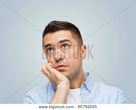 emotions, boredom, laziness and people concept - bored middle aged man over gray background