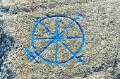 picture of compass rose  - Compass rose sometimes called a windrose engraved on the rock. Painted in blue
