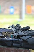 stock photo of shotgun  - A tactical shotgun on a gun case in shooting range - JPG