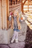 picture of country girl  - cute happy child girl playing with fabric easter chicken at country house - JPG