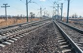 picture of railroad yard  - Railroad tracks stretching into the distance beyond the horizon - JPG