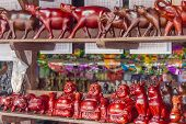 stock photo of carabao  - wooden crafted figurines in a souvenir shop - JPG