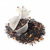 pic of black tea  - Aromatic black dry tea with petals and a tea strainer on white reflective background - JPG