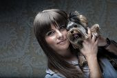 foto of yorkie  - Cute young girl with her Yorkie puppy - JPG